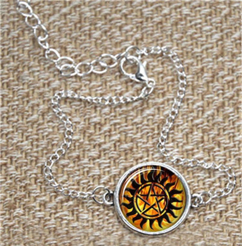 Supernatural fire anti-possession pendant in silver bracelet.