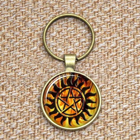 Supernatural fire anti-possession pendant in bronze key chain.