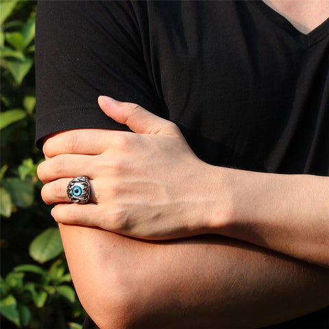A man wearing the Turkish Claw Eye Ring.