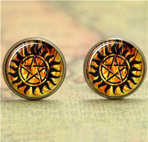 Supernatural fire anti-possession pendant in bronze earrings.