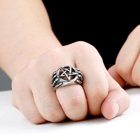 View of dragon claw ring on someone's hand.