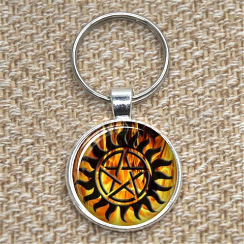 Supernatural fire anti-possession pendant in silver key chain.