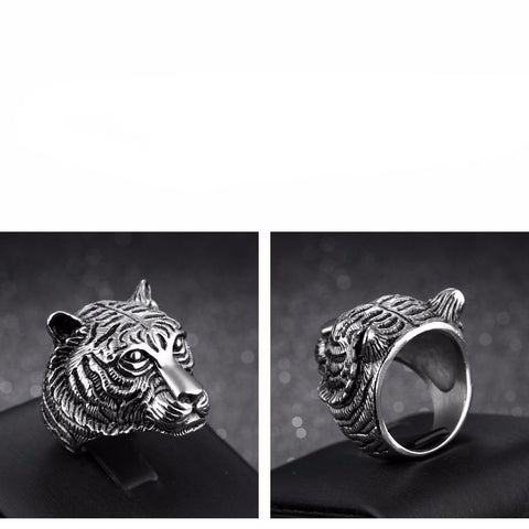 Picture of front and back of silver tiger ring.