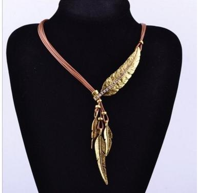 Feather necklace in golden coffee.