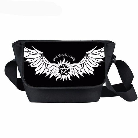"Supernatural messenger bag with angel wings and ""Non Timbo Mala"" printed on it."
