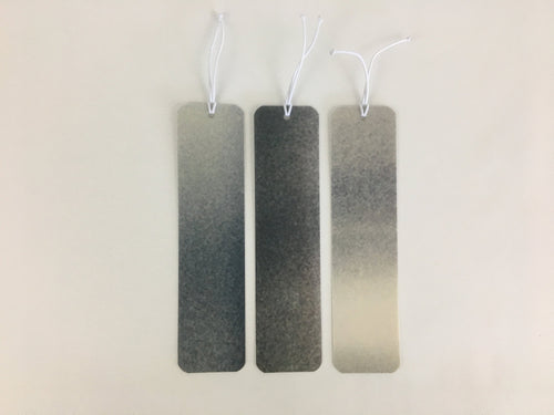 3 bookmarks with a black, gray and off white pattern made from billboard vinyl.