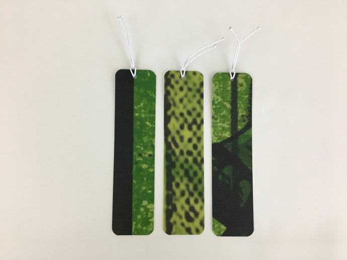 3 bookmarks with a black and green pattern made from billboard vinyl.