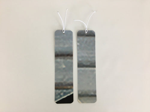 2 bookmarks with a gray horizontal strip pattern made from billboard vinyl.