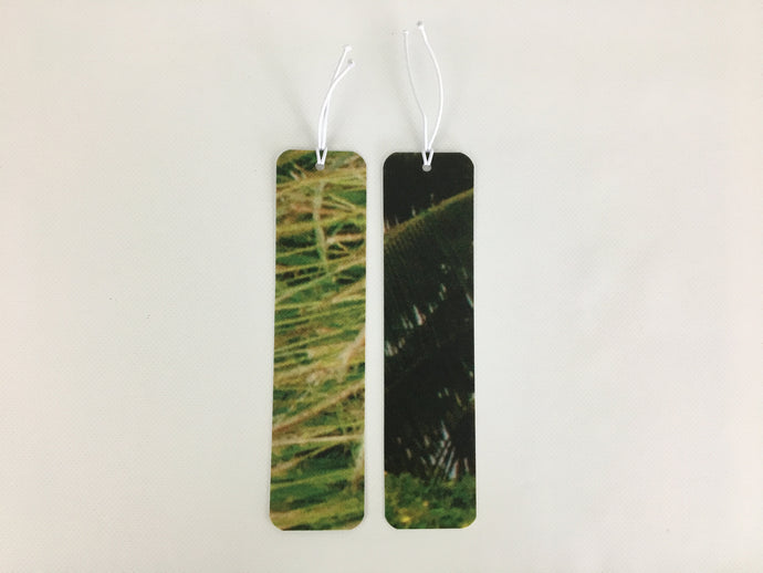 2 bookmarks with green grass and leaf patterns made from billboard vinyl.