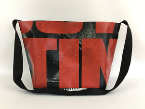 Vinyl tote bag with red typography from a Walking Dead billboard.