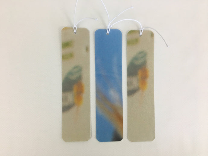 3 bookmarks with abstract light blue and tan patterns made from billboard vinyl.