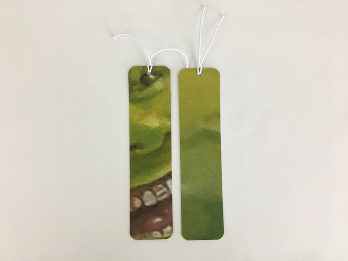 2 bookmarks with a green cartoon face pattern made from billboard vinyl.