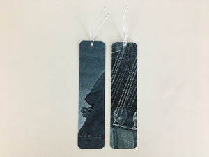 2 bookmarks with a blue and gray pattern made from billboard vinyl.