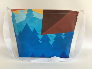 Billboard vinyl tote bag with blue, red and yellow patterns.