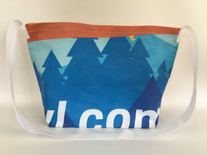 Billboard vinyl tote bag with a pattern of blue evergreen trees.