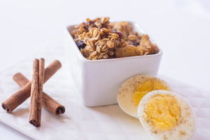 sweetened oatmeal baked with apples and raisins, served with a hard boiled egg. Cinnamon sticks on the side for decoration, not served with prepared meal