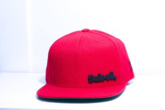 The Classic Sek-sē Red Snapback Cap