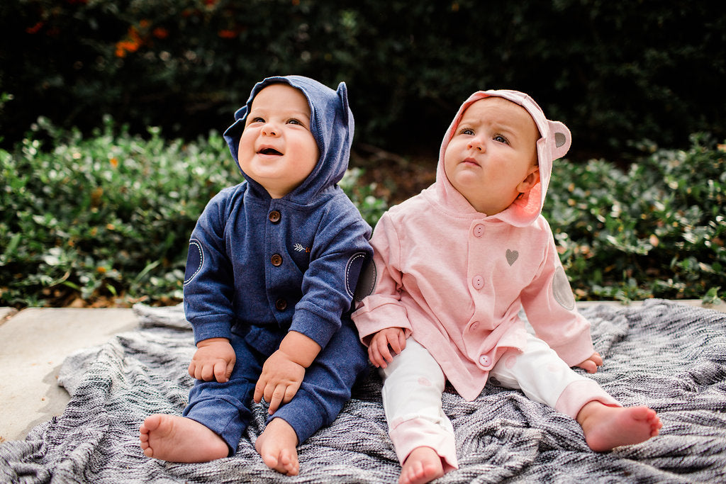 Baby Boy-Girl Twins modeling matching animal hoodies