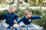 Twin Boys Modeling the Navy Outfit Set with Arrow Pants
