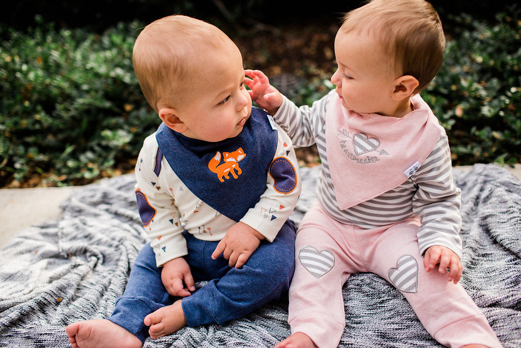 Adorable boy-girl twins in matching outfits