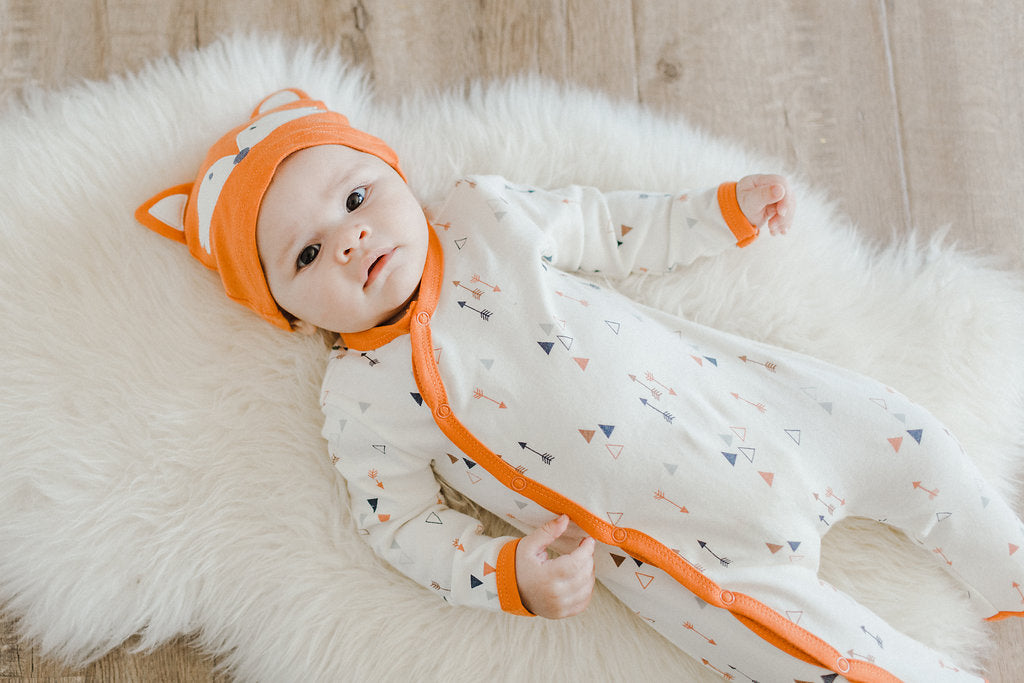 Baby in Asher and Olivia Footie with Fox Hat