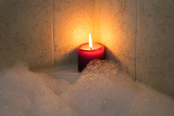 Candles by bubble bath for relaxation