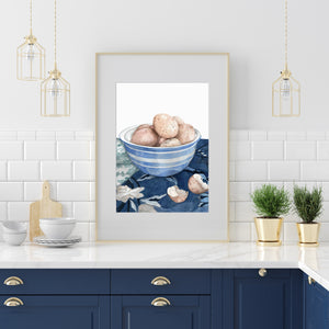 Print of speckled eggs in a blue and white bowl