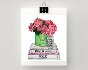 Print of Chanel & Vogue books atop with Laduree vessel holding roses and peonies