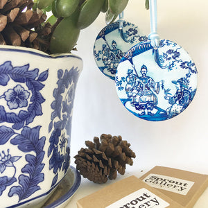 A pair of matching blue and white ceramic ornaments - Chinoiserie round design LCM