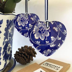 A pair of matching blue and white ceramic ornaments -  beautiful peony design