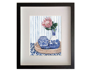 Blue and White vignette with protea on rattan tray