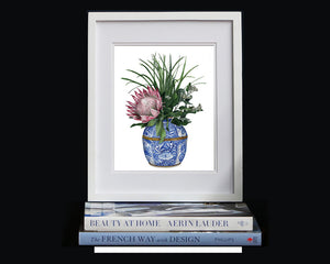 Print of a protea with wattle in a blue and white vase.
