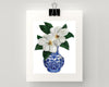 Print of magnolias in a blue and white vase