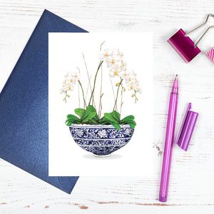 Beautiful orchids in a traditional blue and white chinoiserie bowl card