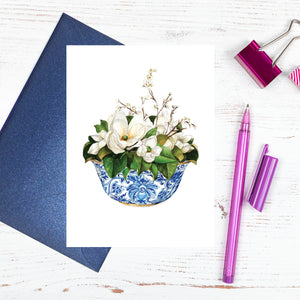 A blue and white bowl of magnolias card