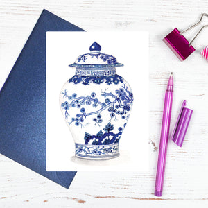 A blue and white cherry blossum card