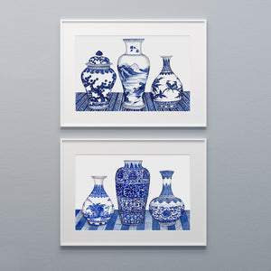 Print of three Blue and white ginger jar and vases on a pattered tablecloth