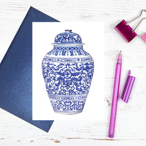 A blue and white ornate ming jar card