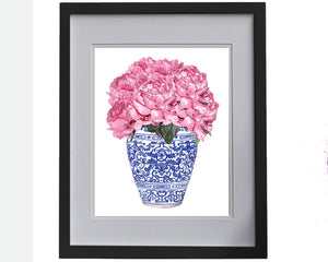 Print of pink peonies in blue and white ming jar.