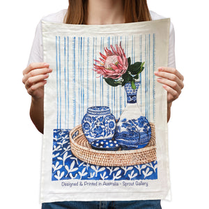 Tea Towel of protea in blue white vase on rattan tray