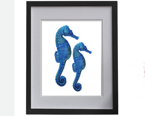 Print of seahorses in blue accents