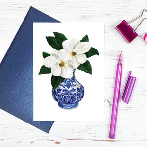 Single orchid in a traditional blue and white vase card