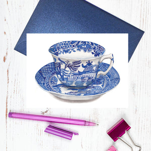 A blue and white Spode Willow design cup and saucer card