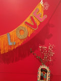love fringe wall textile art by fun cult