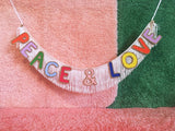 peace and love glittering fringe banner by fun cult