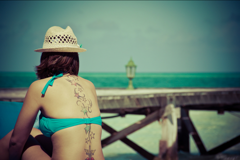 sun-tanning-women-tattoos-beach