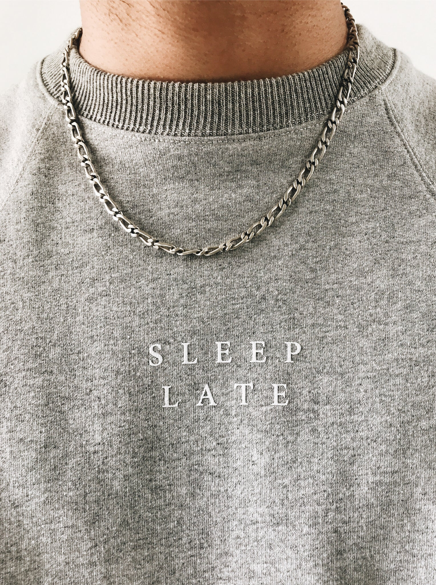 grey crewneck sweatshirt with sleep late logo on center chest