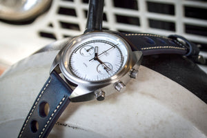 MHD Watches - MHD CR1 Chronograph Watch, White dial with Dark Blue calf leather rally strap The MHDCR1 Timepiece by MHD watches is a 60's automotive inspired men's motoring chronograph Watch, designed by British Car designer Matthew Humphries. Limited edition of 500.