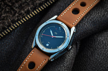 British watch- stainless steel case with black dial and tan leather rally strap