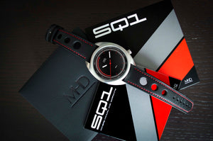 "MHD Watches - MHD SQ1 Daily Driver Watch on red stitched black calf leather rally watch strap.  The MHDSQ1 Timepiece by MHD Watches is a 60's automotive inspired men's daily driver watch, designed by British Car designer Matthew Humphries. Limited edition of 300. The SQ1 dial takes influence from the cars of the same period, in particular the ""in the red zone"" of the rev counters in classic Porsche 911 VDO car dials."